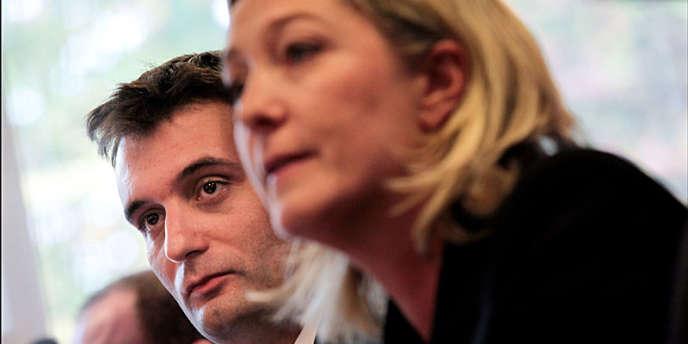 En arrière-plan : Florian Philippot, lors d'une conférence de presse de Marine Le Pen, à Nanterre, le 6 octobre 2011.