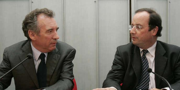François Bayrou et François Hollande, le 26 septembre 2007, à Paris.