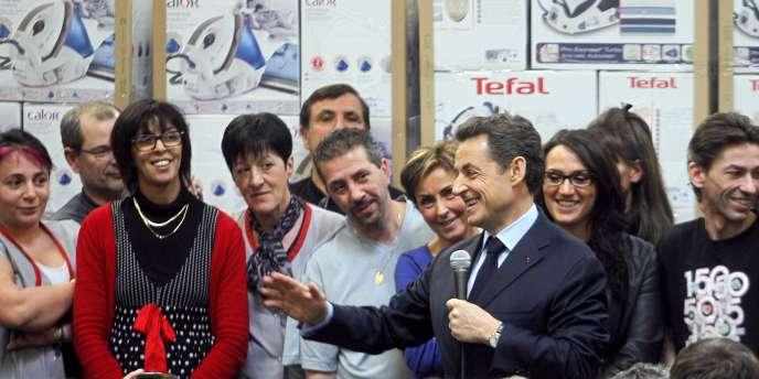 Nicolas Sarkozy lors de sa visite d'une usine du groupe SEB, à Pont-Evèque (Isère), le 19 janvier.
