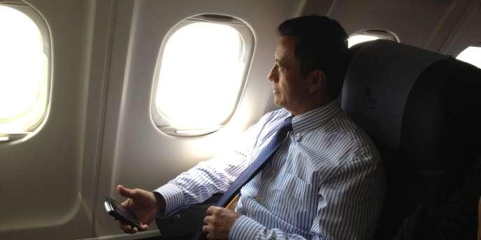 Marc Ravalomanana a bord de l'avion qui devait le ramener à Madagascar, samedi 21 janvier.