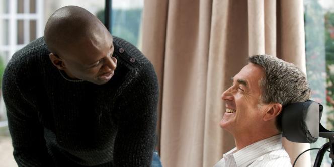 Omar Sy et François Cluzet dans le film français d'Eric Toledano et Olivier Nakache,