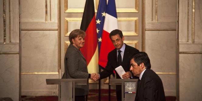 Nicolas Sarkozy et Angela Merkel, à la fin de leur conférence de presse commune à l'Elysée, le 6 février.