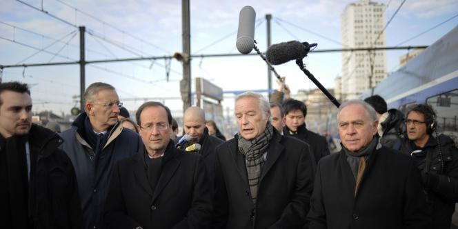 André Vallini, François Hollande et François Rebsamen, à Lyon le 6 février 2012.