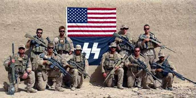 Photo montrant des membres de la compagnie Charlie, du 1er bataillon de reconnaissance des marines, dans la province de Helmand, en novembre 2011.