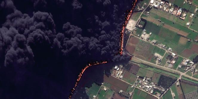 Vue satellite de l'oléoduc de Homs, en flammes, le 15 février 2012.