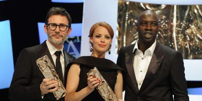 De gauche à droite : le réalisateur Michel Hazanavicius, l'actrice Bérénice Bejo, récompensés par