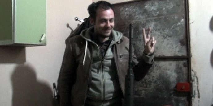 Rémi Ochlik, journaliste photographe, avec des membres de l'Armée syrienne libre peu avant sa mort le 22 février.