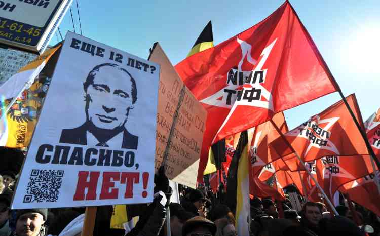 """The opposition movement activists take part in anti-Putin rally in the central Arbat area in Moscow, on March 10, 2012. The poster featuring Russia's Prime Minister Vladimir Putin (L) reads: """"Thank You, No!""""  Russia's protest movement against  Putin rallied today several thousand people for a new demonstration that is a test of their strength and tactics after his crushing election victory.  AFP PHOTO / YURI KADOBNOV"""