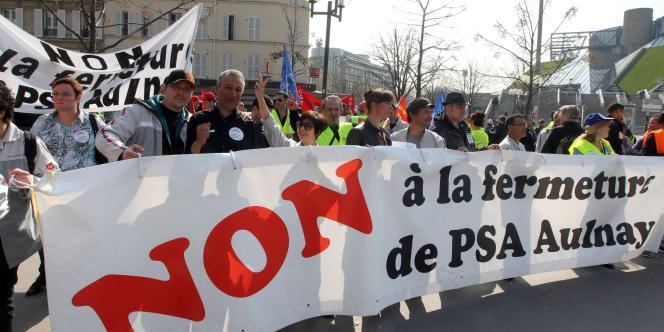 Manifestation des salariés de l'usine PSA d'Aulnay-sous-Bois, à Paris, en mars 2012.