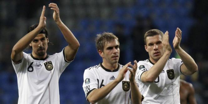 Sami Khedira, Philipp Lahm, Lukas Podolskin, ici à Astana le 12 octobre, visiteront l'ancien camp d'extermination d'Auschwitz pendant l'Euro 2012.