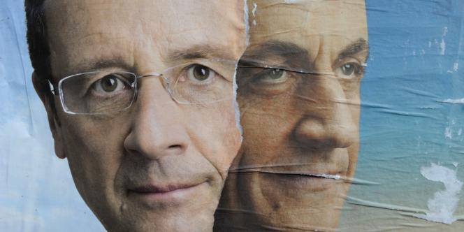 Affiches de campagne de François Hollande et Nicolas Sarkozy, sur un mur, à Paris, le 16 avril 2012.