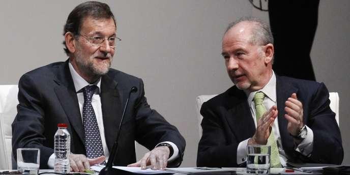 Mariano Rajoy, le président du gouvernement espagnol, et Rodrigo Rato, ancien président de Bankia, en mars dernier. La banque a été nationalisée et devrait être auditée par Goldman Sachs.