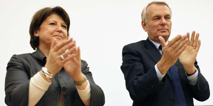 Martine Aubry et Jean-Marc Ayrault avant une réunion du groupe socialiste à l'Assemblée nationale, le 9 mai.