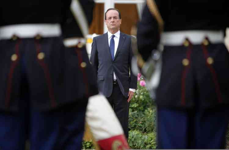 France's new President Francois Hollande attends a military ceremony in the garden of the Elysee Palace following his investiture  in Paris May 15, 2012.  REUTERS/Thibault Camus/Pool   (FRANCE - Tags: POLITICS)