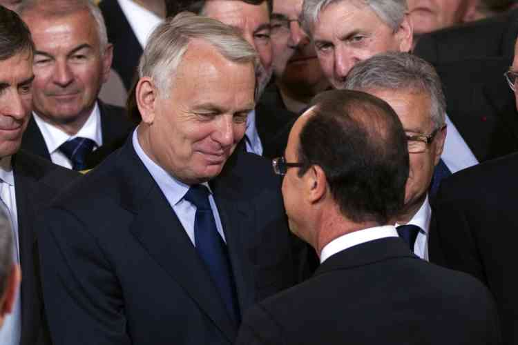 France's newly-elected President Francois Hollande (R) speaks with Jean-Marc Ayrault, Socialist group head at the National Assembly, at the handover ceremony at the Elysee Palace in Paris May 15, 2012.  REUTERS/Charles Platiau  (FRANCE - Tags: POLITICS)