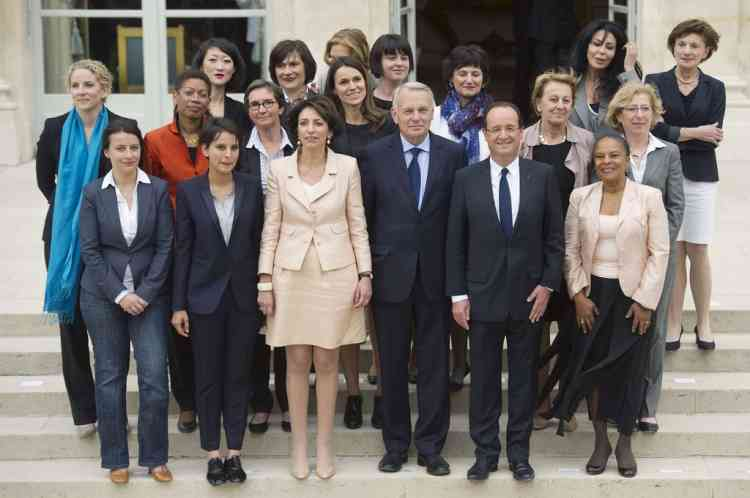 Family picture of the newly appointed French government taken on May 17, 2012 at the Elysee Palace in Paris. From bottom - Prime Minister, Jean-Marc Ayrault; French President Francois Hollande 2ndR and 3rd R) poses with the women of the government.  JM for Junior Minister and M for Minister (FROM BOTTOM - 1st row, LtoR) M for Equality of Territories and Housing, Cecile Duflot; M for Women's Rights and Government Spokeperson, Najat Vallaud-Belkacem; Social Affairs and Health M, Marisol Touraine and Justice Minister, Christiane Taubira.  AFP PHOTO LIONEL BONAVENTURE