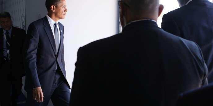 Le président Barack Obama à la sortie d'une conférence de presse, lors du G8 de L'Aquila (Italie), en juillet 2009.