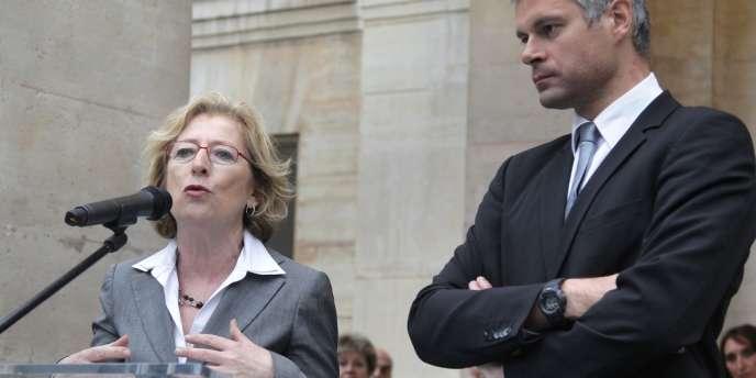 Geneviève Fioraso avec son prédécesseur, Laurent Wauquiez, le 17 mai.