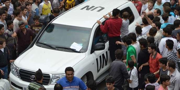 Des observateurs de la mission de l'ONU, le 29 mai, dans la province d'Idlib dans le nord de la Syrie.