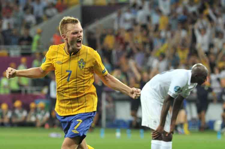 Swedish midfielder Sebastian Larsson celebrates after scoring a goal during the Euro 2012 football championships match Sweden vs France on June 19, 2012 at the Olympic Stadium in Kiev. AFP PHOTO / GENYA SAVILOV
