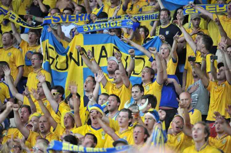 Swedish fans cheer before the Euro 2012 football championships match Sweden vs France on June 19, 2012 at the Olympic Stadium in Kiev. AFP PHOTO / GENYA SAVILOV