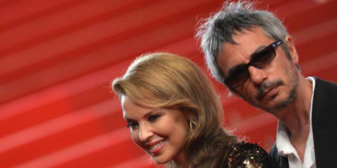 Kylie Minogue et Leos Carax lors de la projection du film