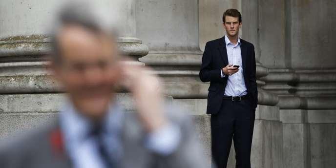 Employés dans le quartier de la City à Londres, le 29 juin.