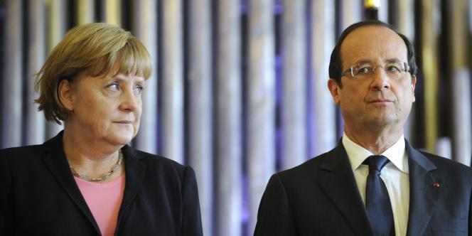 François Hollande et Angela Merkel à Reims, dimanche 8 juillet.