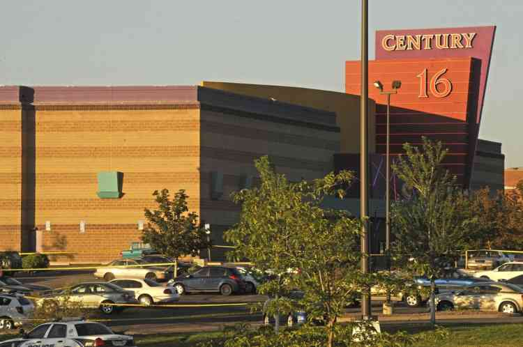 The Century 16 Theatre where a masked gunman killed 14 people at a midnight showing of the new Batman movie in Aurora, Colorado July 20, 2012.  A masked gunman killed 14 people at a midnight showing of the new Batman movie in a suburb of Denver early on Friday, sparking pandemonium when he hurled a teargas canister into the auditorium and opened fire on moviegoers.   REUTERS/Evan Semon  (UNITED STATES - Tags: CRIME LAW)