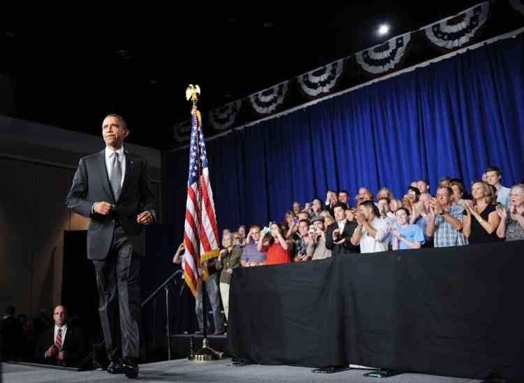 US President Barack Obama arrives on stage to speak on the shootings in Aurora, Colorado at what was scheduled originally as a campaign event at Harborside Event Center July 20, 2012 in Fort Myers, Florida. AFP PHOTO/Mandel NGAN