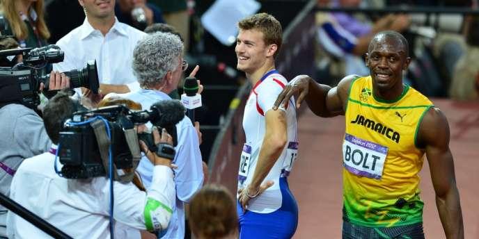 Usain Bolt et Christophe Lemaitre, ici à l'issue des demi-finales du 200 m, courent-ils dans la même cour ? Réponse jeudi.