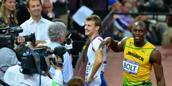 Lemaitre et Bolt après les demi-finales du 200 m, le 8 août.