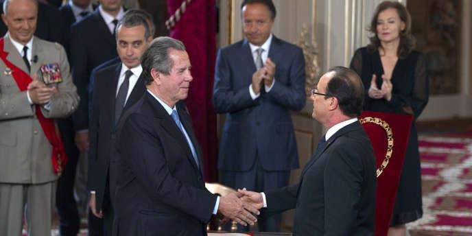 Jean-Louis Debré, le président du Conseil constitutionnel et François Hollande, lors de la passation de pouvoir, le 15 mai, au palais de l'Elysée.