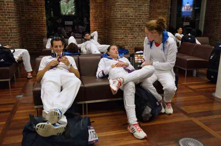 French gold medalist athlete Renaud Lavillenie (L) and swimmer Camille Muffat (R) relaxe prior to take a train back to Paris at St Pancras railway station after the London 2012 Olympic Games on August 13, 2012 in London. France finished the London Olympics Games with 34 medals including 11 gold, 11 silver and 12 bronze, and placed on the seventh position in the all nations ranking. AFP PHOTO / ERIC FEFERBERG