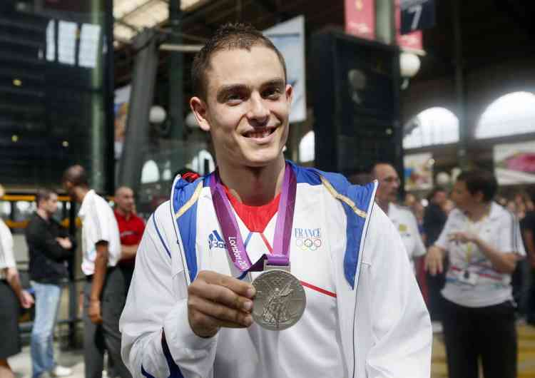 French cycling track silver medalist Michael D'Almeida poses upon his arrival at the Gare du Nord railway station, in Paris on August 13, 2012. France finished the London Olympics Games with 34 medals including 11 gold, 11 silver and 12 bronze, and placed on the seventh position in the all nations ranking. AFP PHOTO / KENZO TRIBOUILLARD