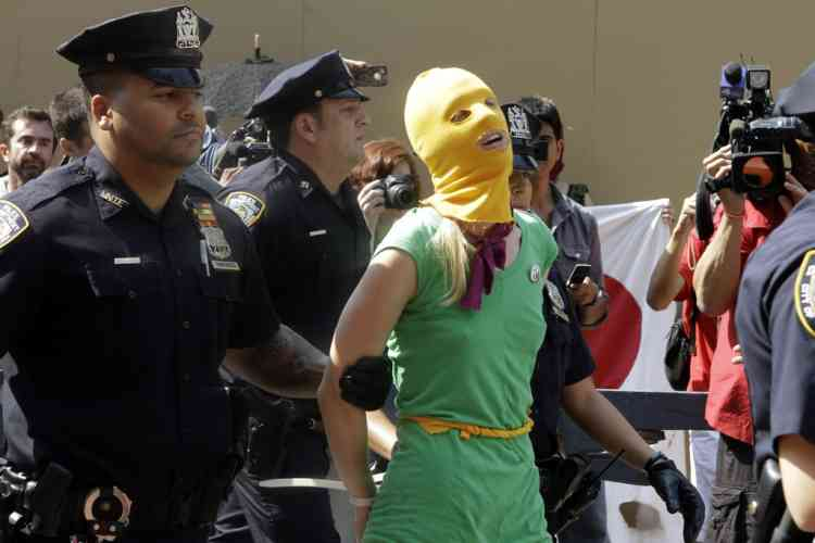 A protester is arrested during a demonstration in front Russian consulate in support of Russian punk band Pussy Riot, Friday, Aug. 17, 2012 in New York.  A Russian judge found three members of the provocative punk band guilty of hooliganism on Friday, in one of the most closely watched cases in recent Russian history. The judge said the three band members committed hooliganism driven by religious hatred and offending religious believers. The three were arrested in March after a guerrilla performance in Moscow's main cathedral calling for the Virgin Mary to protect Russia against Vladimir Putin, who was elected to a new term as Russia's president a few days later. (AP Photo/Alex Katz)