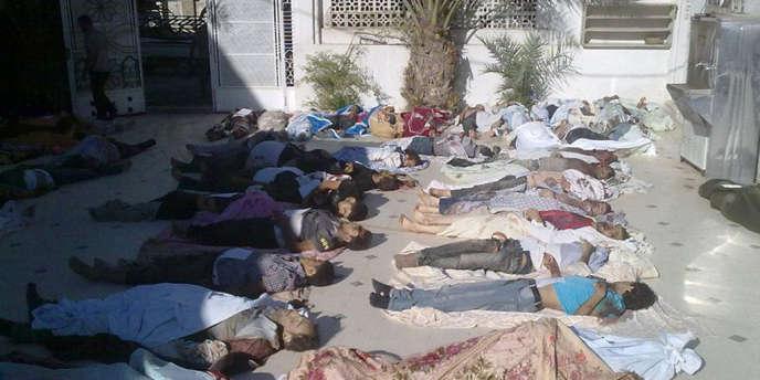 Plusieurs centaines de corps ont été retrouvés à Daraya, près de Damas, le 26 août.