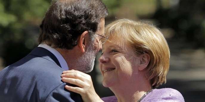 Le chef du gouvernement espagnol, Mariano Rajoy, et la chancelière allemande, Angela Merkel, au palais de La Moncloa à Madrid, jeudi 6 septembre.