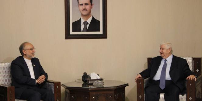 Le ministre syrien des affaires étrangères avec son homologue iranien, le 19 septembre à Damas.