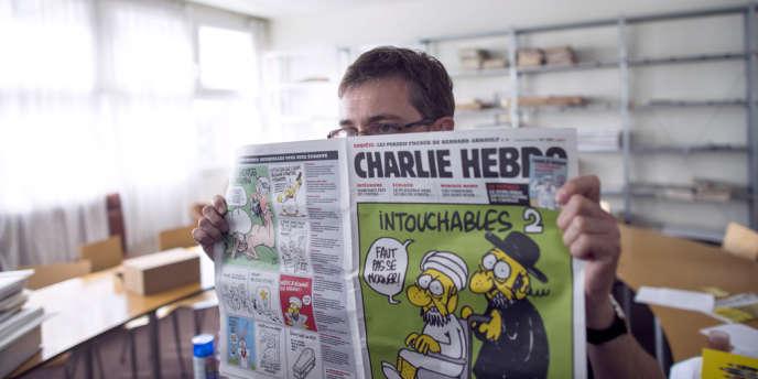 Le dessinateur Charb, dans les locaux de Charlie Hebdo, en septembre 2012.