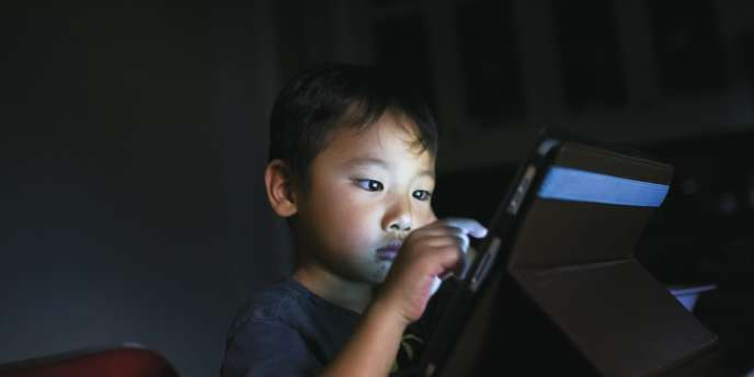Une étude récente de  l'institut CSA montre que dans 71 % des foyers équipés, les moins de 12 ans font un usage régulier des tablettes numériques. Photo:Michael Appleton/The New York Times-REDUX-REA