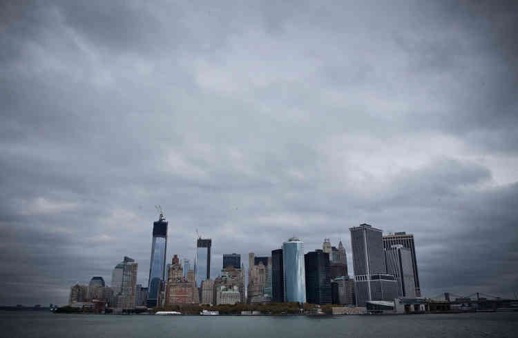 NEW YORK, NY - OCTOBER 28: The skyline of lower Manhattan is seen from the Staten Island Ferry prior to the arrival of Hurricane Sandy on October 28, 2012 in New York City. Sandy, which has already claimed over 50 lives in the Caribbean, is predicted to bring heavy winds and floodwaters as the mid-atlantic region prepares for the damage.   Andrew Burton/Getty Images/AFP== FOR NEWSPAPERS, INTERNET, TELCOS & TELEVISION USE ONLY ==
