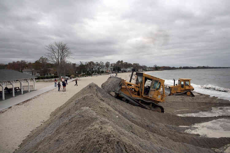 WESTPORT, CT - OCTOBER 28: Earth movers build protective berms on Compo Beach as the first signs of Hurricane Sandy approach on October 28, 2012 in Westport, Connecticut. The storm, which could affect tens of millions of people in the eastern third of the U.S., is expected to bring days of rain, high winds and possibly heavy snow in parts of Ohio and West Virginia. New York Governor Andrew Cuomo announced that New York City will close its bus, subway and commuter rail service Sunday evening ahead of the storm.   Spencer Platt/Getty Images/AFP== FOR NEWSPAPERS, INTERNET, TELCOS & TELEVISION USE ONLY ==