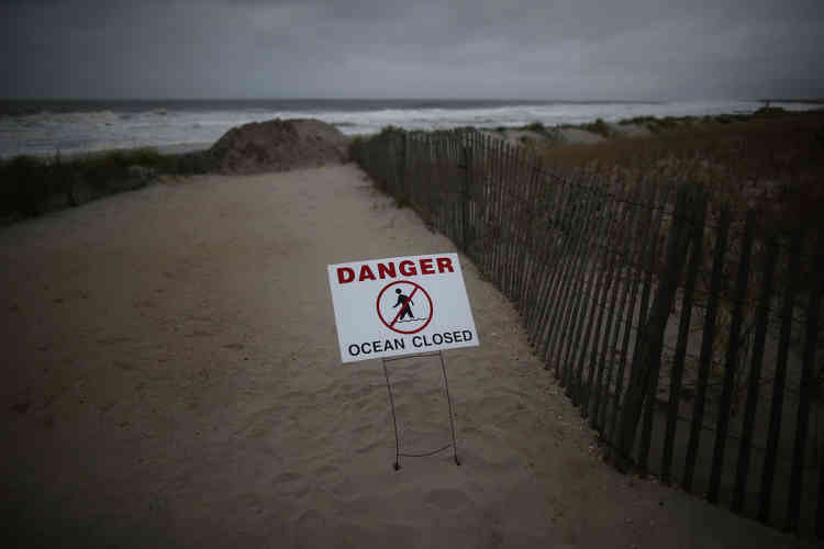 """OCEAN CITY, NJ - OCTOBER 28: A sign reads """"Danger Ocean Closed"""" at the entrance to the beach, due to approaching Hurricane Sandy, on October 28, 2012 in Ocean City, New Jersey. New Jersey is expected to be hit hard by approaching storm sometime on Monday, bringing heavy winds and floodwaters.   Mark Wilson/Getty Images/AFP== FOR NEWSPAPERS, INTERNET, TELCOS & TELEVISION USE ONLY =="""