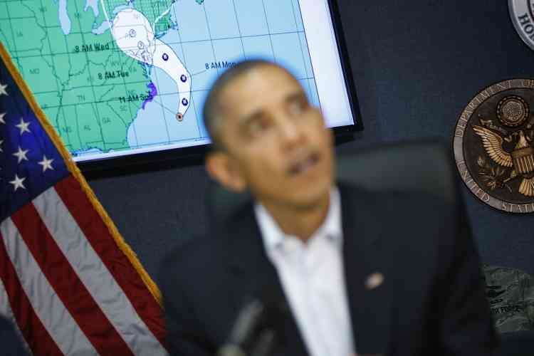 """A tracking model of Hurricane Sandy is pictured on a video screen behind U.S. President Barack Obama during a briefing on the storm at Federal Emergency Management Agency (FEMA) headquarters in Washington, October 28, 2012. Obama warned on Sunday that Hurricane Sandy was a """"serious and big storm"""" and called on East Coast residents to heed the orders of state and local officials to protect themselves from its onslaught. REUTERS/Jonathan Ernst  (UNITED STATES - Tags: POLITICS ENVIRONMENT)"""