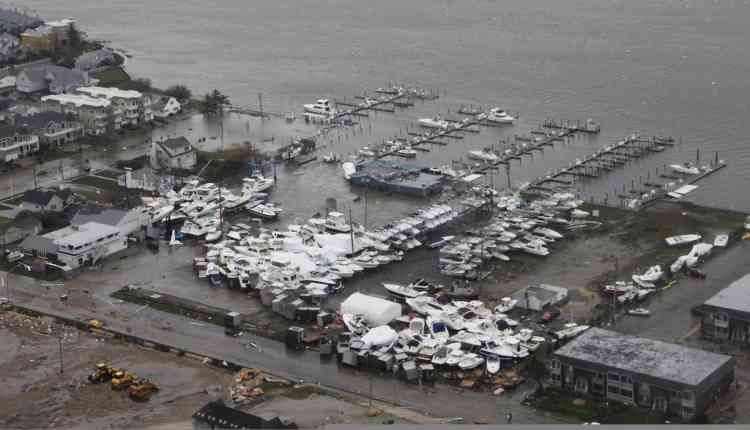 """Damage after Hurricane Sandy made landfall on the southern New Jersey coastline is seen in this U.S. Coast Guard handout photo in Brigantine, New Jersey, October 30, 2012. In the storm's wake, Obama issued federal emergency decrees for New York and New Jersey, declaring that """"major disasters"""" existed in both states. One disaster-forecasting company predicted economic losses could ultimately reach $20 billion (12.4 billion pounds), only half insured.  REUTERS/U.S.Coast Guard/Petty Officer 2nd Class Erik Swanson/Handout  (UNITED STATES - Tags: ENVIRONMENT DISASTER) FOR EDITORIAL USE ONLY. NOT FOR SALE FOR MARKETING OR ADVERTISING CAMPAIGNS"""