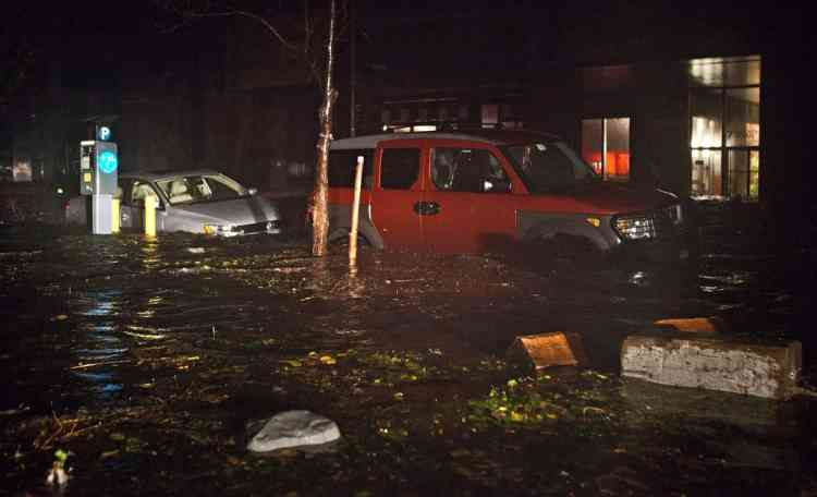 NEW YORK, NY - OCTOBER 29: Flooded cars, caused by Hurricane Sandy, are seen on October 29, 2012, in the Financial District of New York, United States. Hurricane Sandy, which threatens 50 million people in the eastern third of the U.S., is expected to bring days of rain, high winds and possibly heavy snow. New York Governor Andrew Cuomo announced the closure of all New York City will bus, subway and commuter rail service as of Sunday evening   Andrew Burton/Getty Images/AFP== FOR NEWSPAPERS, INTERNET, TELCOS & TELEVISION USE ONLY ==