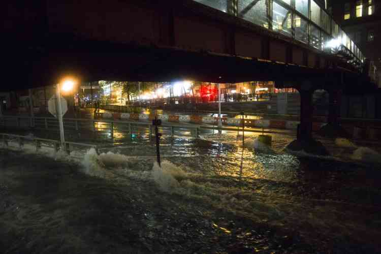 Sea water floods the entrance to the Brooklyn Battery Tunnel, Monday, Oct. 29, 2012, in New York. Sandy continued on its path Monday, as the storm forced the shutdown of mass transit, schools and financial markets, sending coastal residents fleeing, and threatening a dangerous mix of high winds and soaking rain.  (AP Photo/ John Minchillo)
