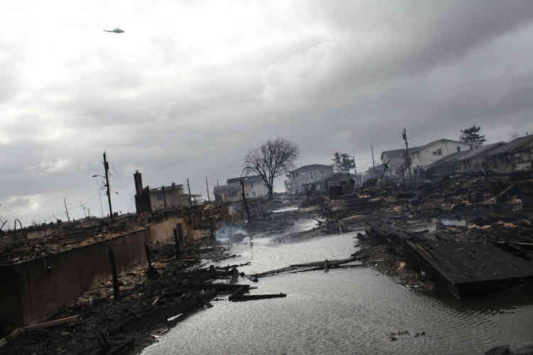 NEW YORK, NY - OCTOBER 30: Homes destroyed during Hurricane Sandy are viewed on October 30, 2012 in the Breezy Point neighborhood of the Queens borough of New York. At least 33 people were reported killed in the United States by Sandy as millions of people in the eastern United States have awoken to widespread power outages, flooded homes and downed trees. New York City was hit especially hard with wide spread power outages and significant flooding in parts of the city.   Spencer Platt/Getty Images/AFP== FOR NEWSPAPERS, INTERNET, TELCOS & TELEVISION USE ONLY ==