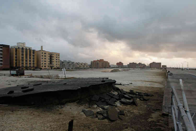 """LONG BEACH, NY - OCTOBER 30: Sections of the old boardwalk are seen destroyed by flooding from Hurricane Sandy on October 30, 2012 in Long Beach, New York. The storm has claimed at least 33 lives in the United States, and has caused massive flooding across much of the Atlantic seaboard. U.S. President Barack Obama has declared the situation a """"major disaster"""" for large areas of the U.S. east coast, including New York City, with widespread power outages and significant flooding in parts of the city.   Mike Stobe/Getty Images/AFP== FOR NEWSPAPERS, INTERNET, TELCOS & TELEVISION USE ONLY =="""